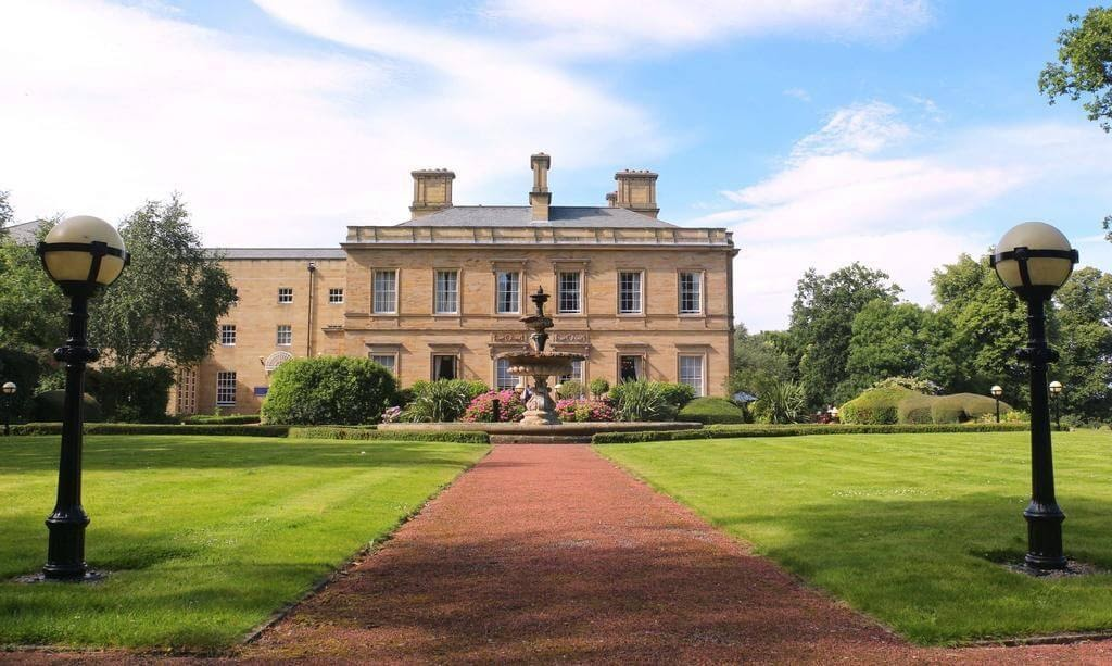 A front few of Oulton Hall on a sunny day