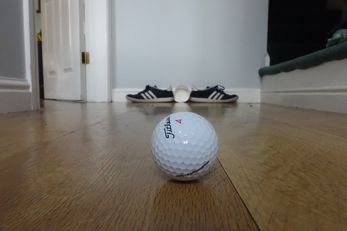 Practice golf at home with a pair of shoes